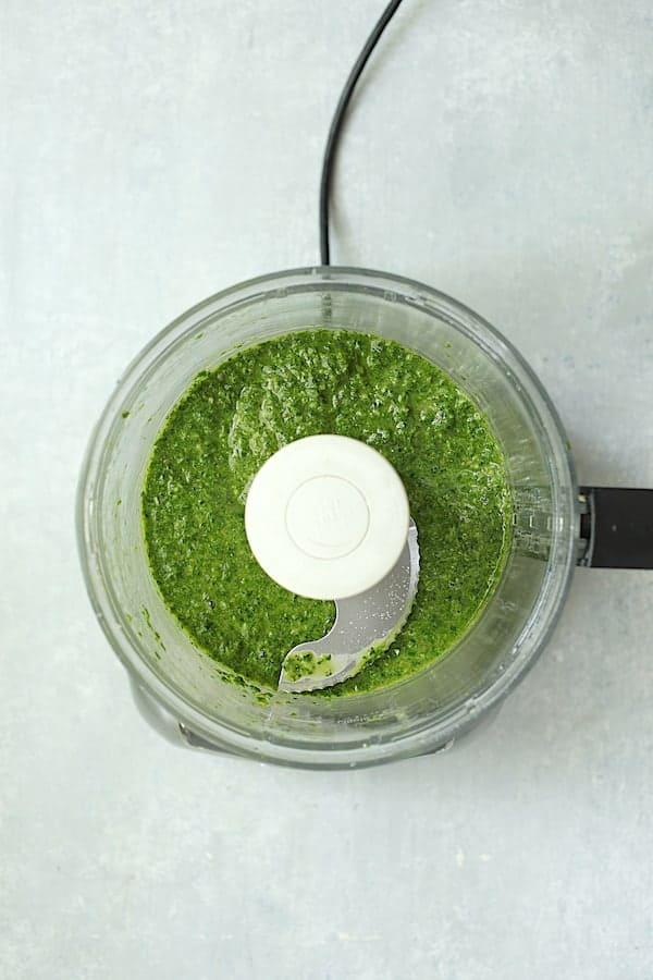 Overhead shot of basil salsa verde in food processor