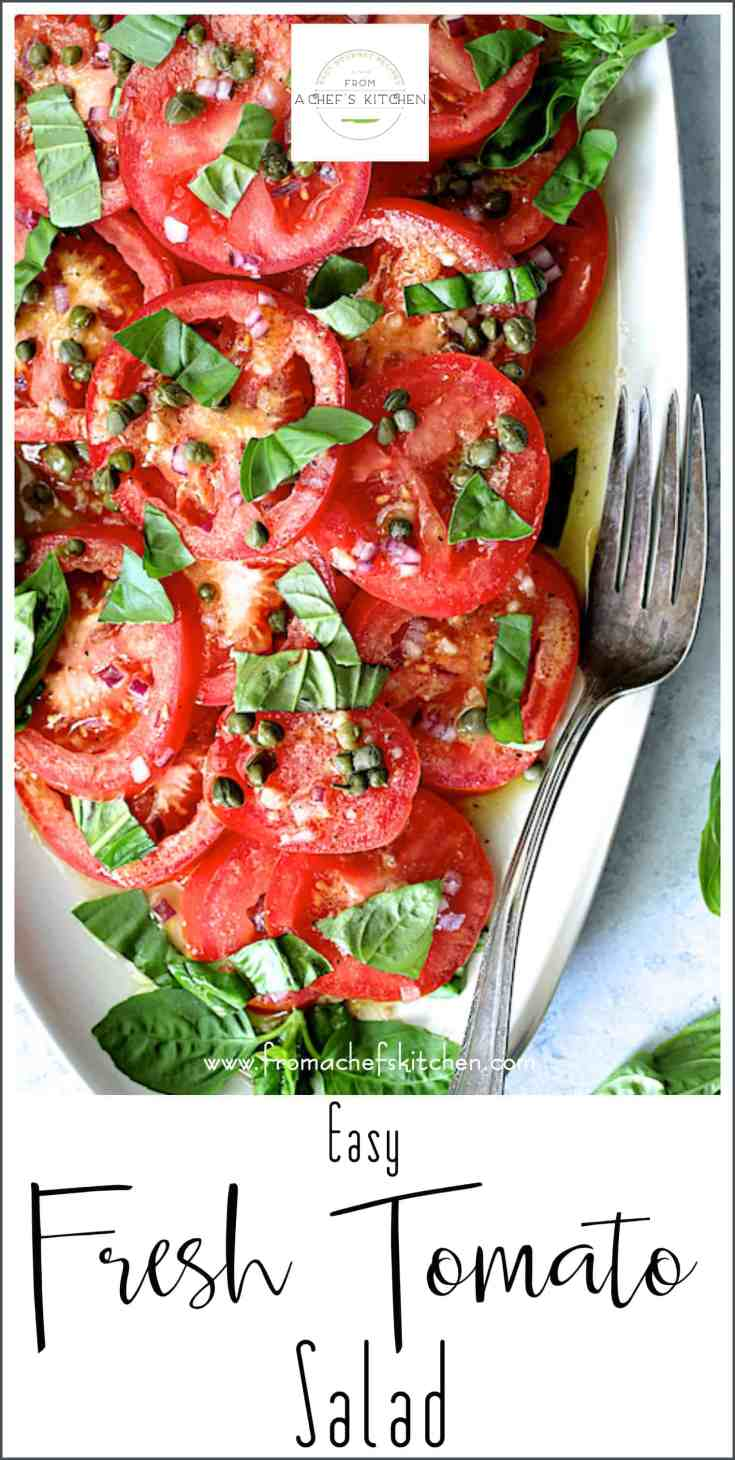 Easy Fresh Tomato Salad is the tomato salad you want to make this summer and every summer from now on.  Fresh summer tomatoes take center stage with a supporting cast of a delicious vinaigrette dressing, finely chopped red onion, capers for a salty, briny kick and lots of fresh basil!