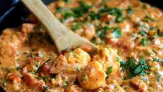 Smothered Shrimp with Andouille Sausage and Creamy Parmesan Peppercorn Grits