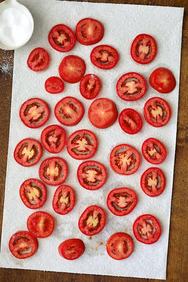 Yellow Squash and Tomato Gratin - Overhead shot of tomatoes draining on paper towels