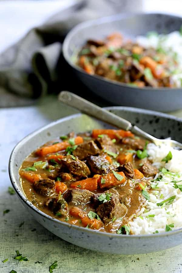Pressure Cooker Indian Curry Beef Stew - Stew served up in gray bowls with white basmati rice