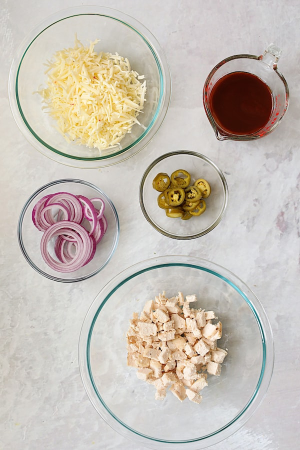 Topping ingredients for Skillet Barbecue Chicken Pizza