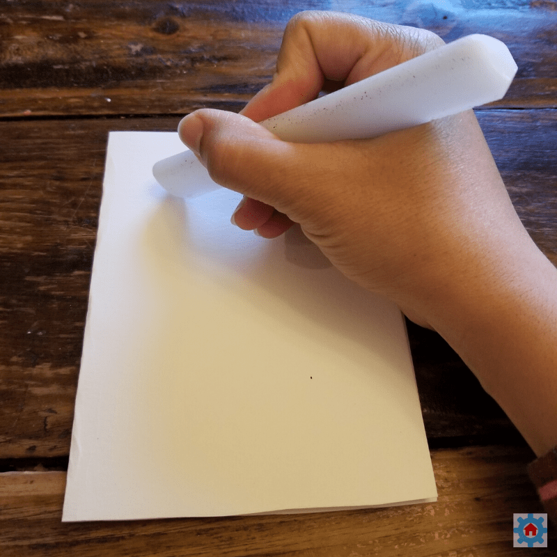 Using a wax stick to draw hearts.