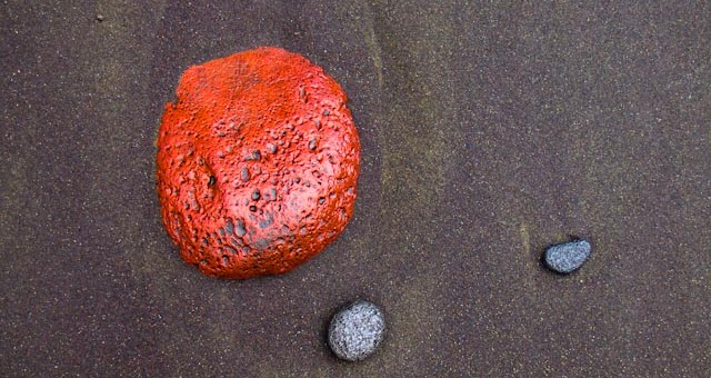 Red rock found on the shoreline of Polulu valley. Hawi, Hawaii