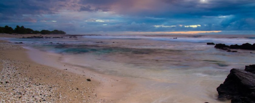 Looking down the beach at Pine Tree's during a dramatic skies sunset