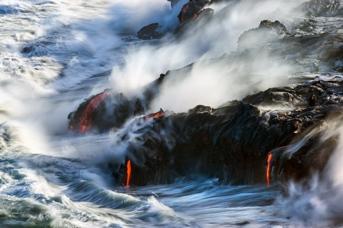 Lava flows into the ocean from the delta of Kamokuna Point