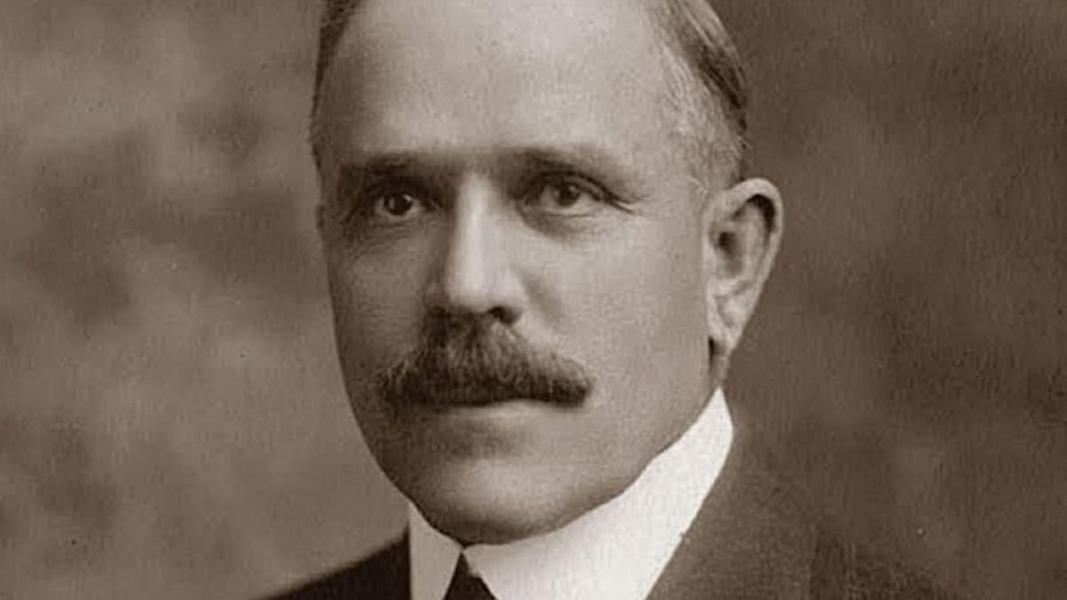 A black-and-white headshot of Joseph F Merrill