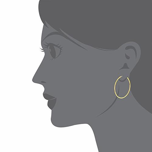 Golden earrings Isabelle Huppert in Elle (2016)