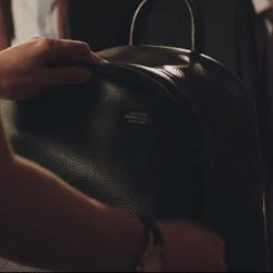Black leather backpack in Molly's Game (2017)