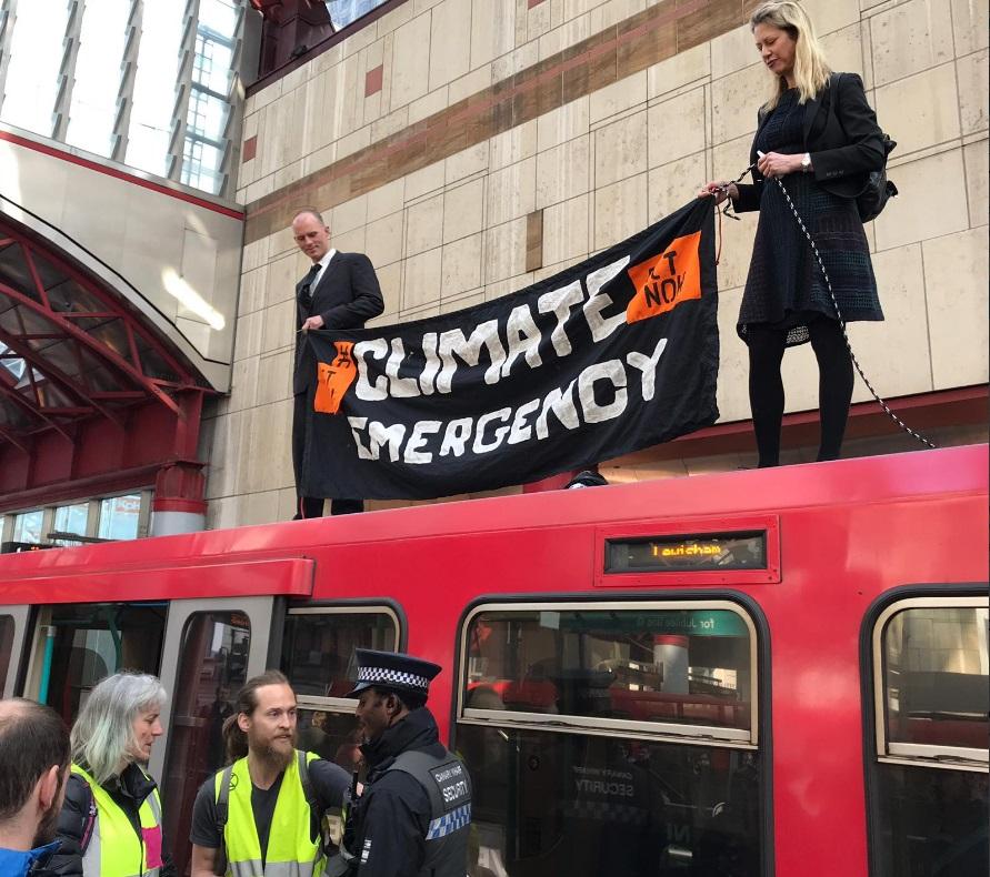 Climate protestors scale DLR train to stop services