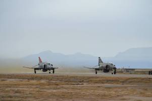 Two QF-4 Phantom's taxi on the runway before taking off during the Phinal Phlight event, Dec. 21, 2016 at Holloman Air Force Base, N.M. The F-4 Phantom II entered the Air Force inventory in 1963, where it served as the primary fighter-bomber throughout the 1960's and 1970's. (U.S. Air Force photo by Staff Sgt. Eboni Prince)