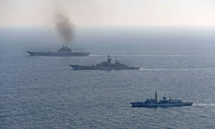 Image of HMS St Albans (foreground), seen here with the Russian Warships Petr Velikiy (centre) and the Admiral Kuznetsov (background). She was escorting the ships as part of her Fleet Ready Escort duties. Image credit: Crown Copyright