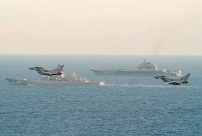 Image of a RAF Typhoon with HMS St Albans seen here in the foreground, with the Russian Warships Petr Velikiy (centre) and the Admiral Kuznetsov (background). Image credit: Crown Copyright