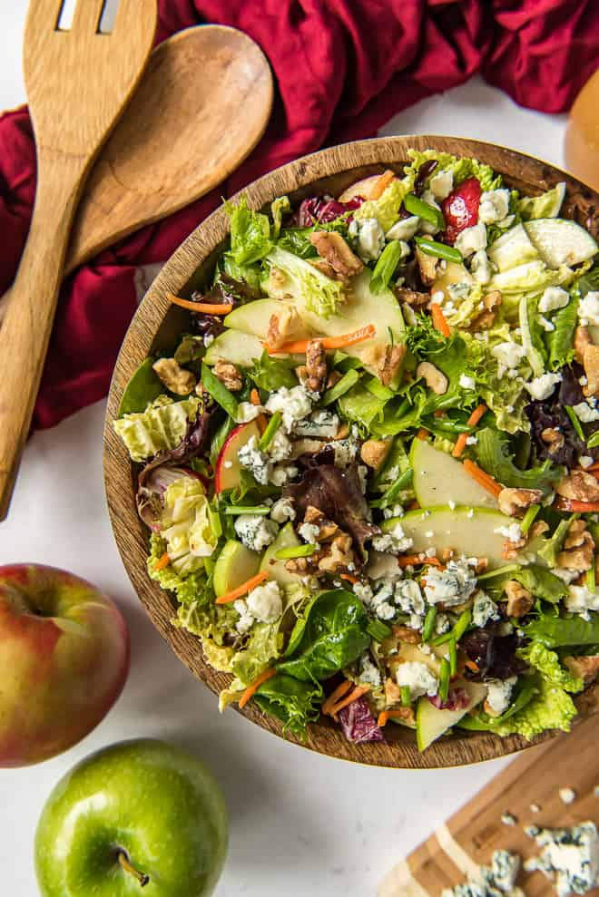 Apple Cabbage Salad with Walnuts and Gorgonzola in a large wooden serving bowl.