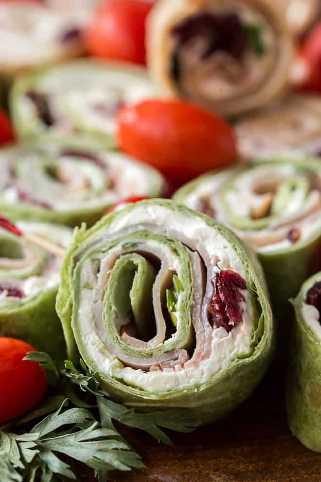 A pinwheel made with green Mission Garden Spinach Herb Wraps.