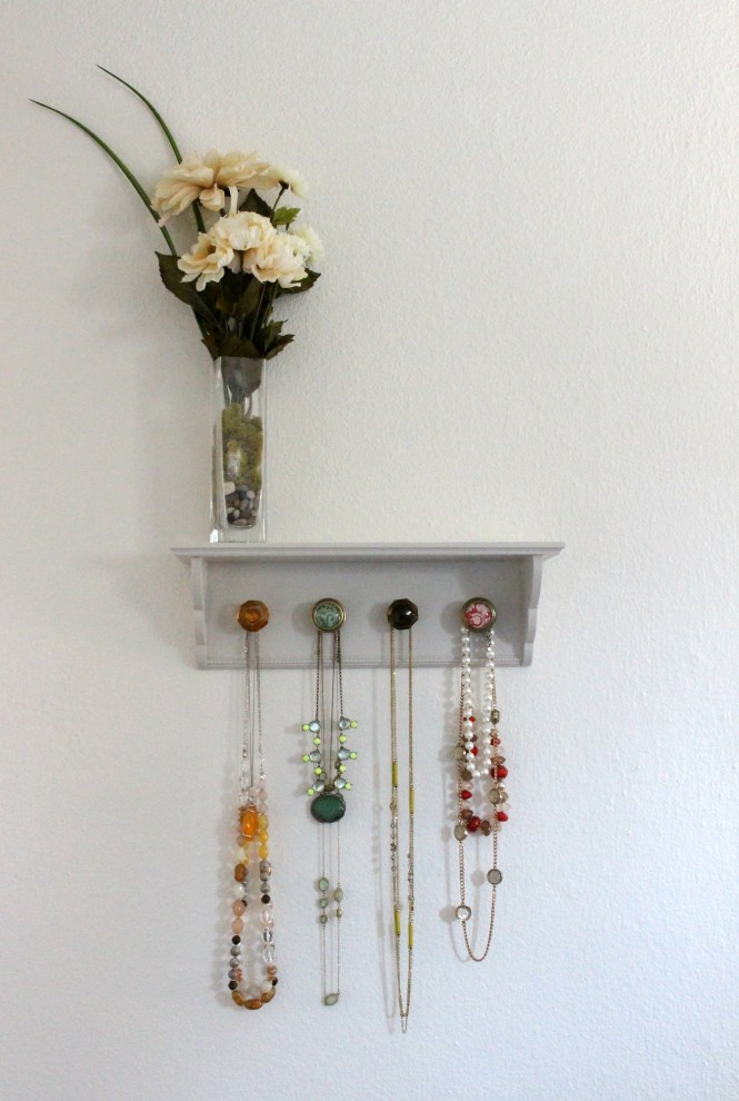 DIY jewelry shelf with colored knobs, neutral bedroom, flowers