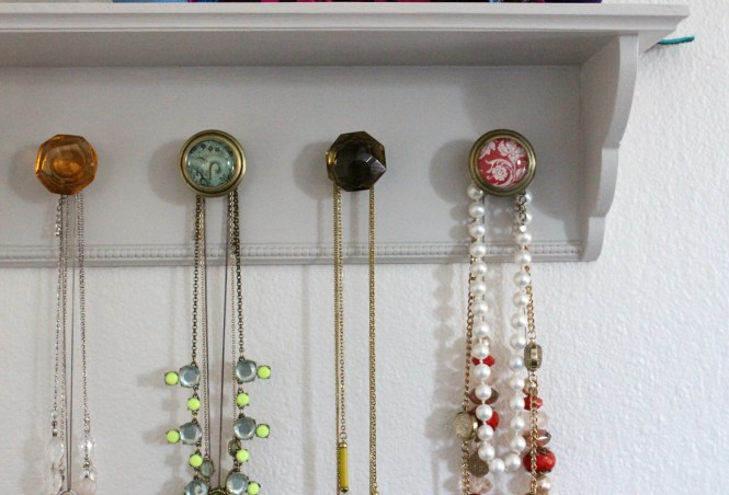 DIY necklace hanger shelf with colorful drawer pulls close-up