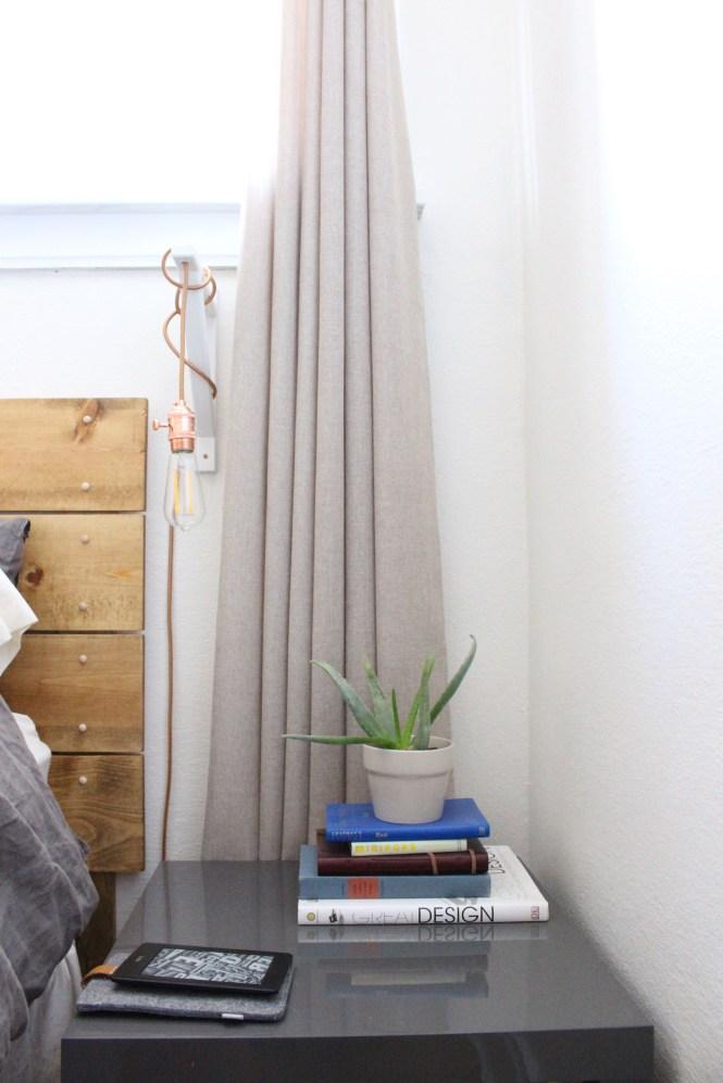 Simple bedside table, gray Ikea lack, rose gold DIY pendant light