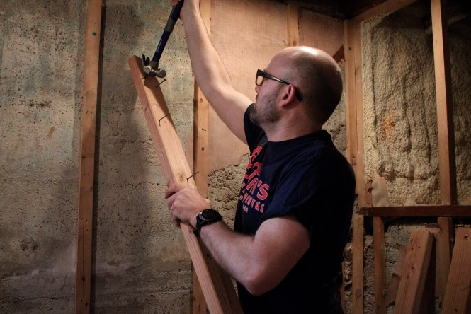 Jesse taking down shower framing and nails