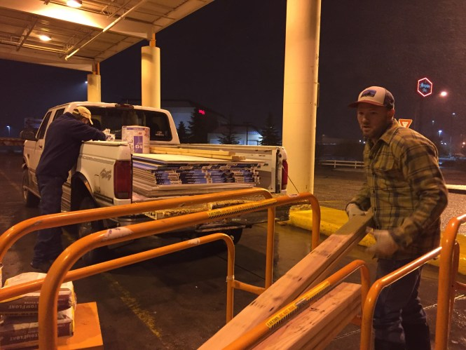 Jesse and Kerry loading up drywall, lumber