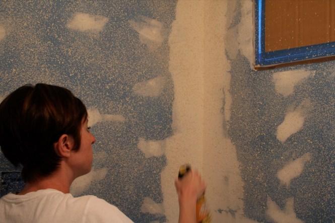 Applying Homax wall texture spray to bathroom walls