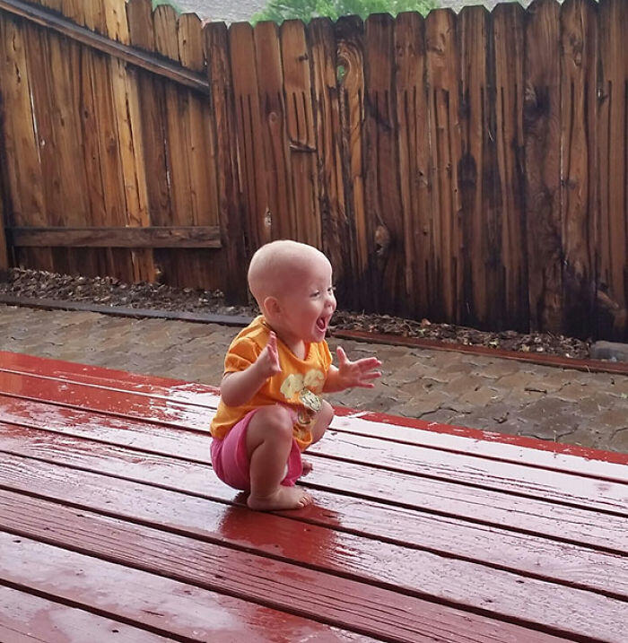 My Daughter Playing In/Seeing Rain For The First Time Yesterday