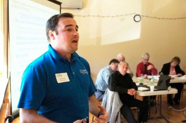 NextEra Project manger Ben Greenhouse makes his case, unsuccessfullu it seems, to North Frontenac Counciil at a public meeting in Harlowe last week.