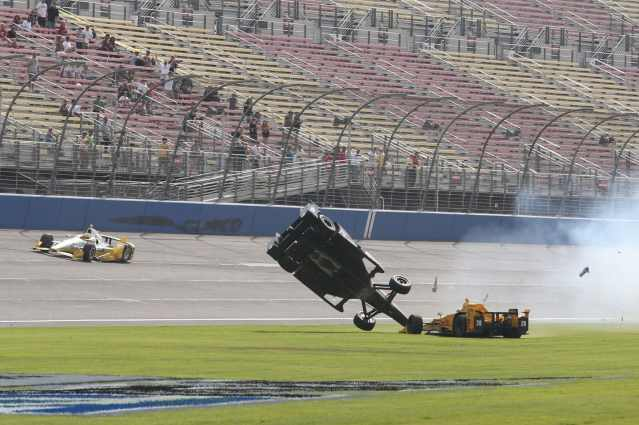 Ryan Briscoe flips after contact with Ryan Hunter-Reay at Auto Club Speedway in Fontana, CA