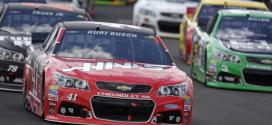 Kurt Busch leads a pack of cars in the Windows 10 400 at Pocono Raceway