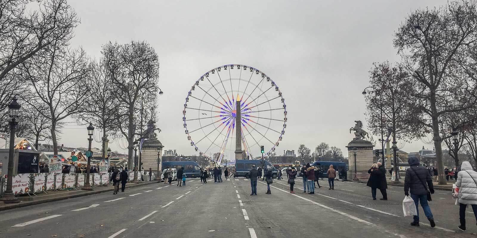 Paris' ferris wheel from Avenue des Champs Elysées on a gray Winter day.