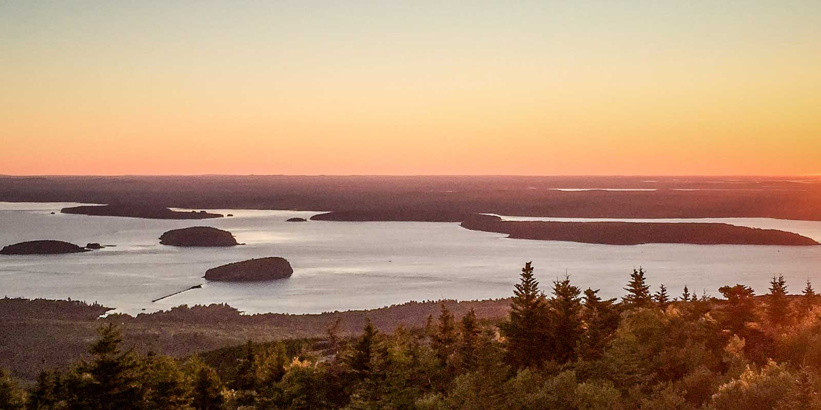 Landscape view looking down on the Porcupine Islands from the top of Cadillac Mountain during sunrise.