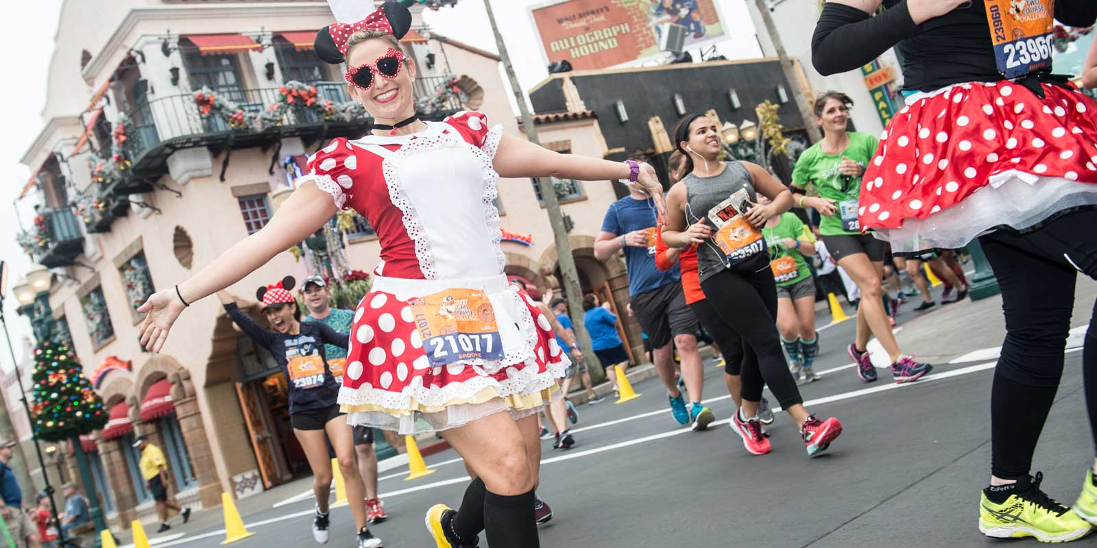 Woman dressed as Minnie Mouse running the Disney Wine and Dine Half Marathon.