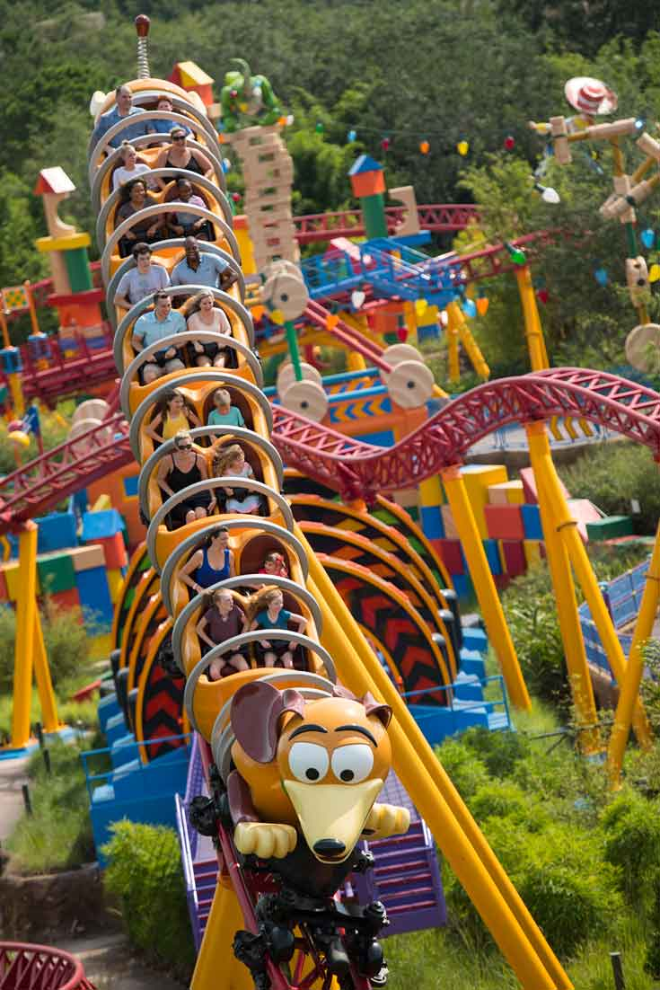 Portrait shot of the Slinky Dog Dash roller coaster going down a hill at Hollywood Studios' Toy Story Land.