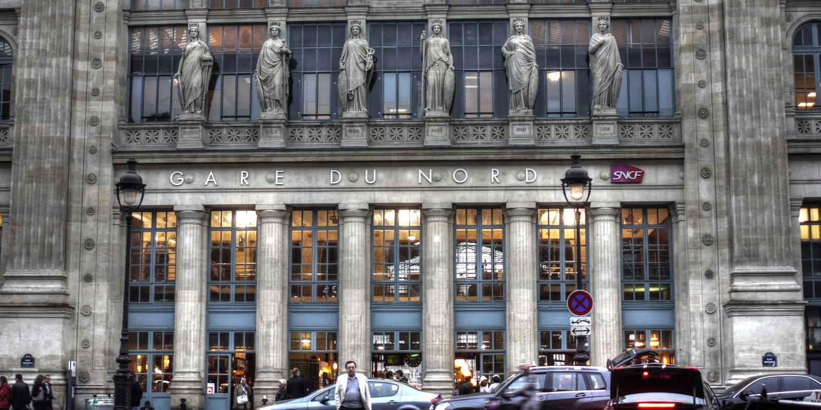 Landscape view of the outside of the Gare du Nord station in Paris, France.