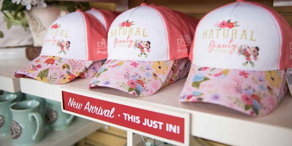 Closeup of a store shelf with Epcot Flower and Garden Festival hats.