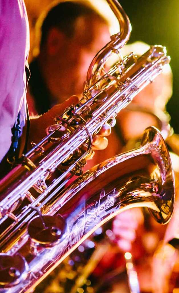 Closeup of a saxophone being played.