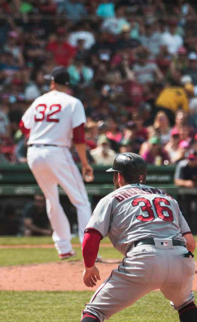 The Boston Red Sox, featuring pitcher Matt Barnes in #32, playing at Fenway Park.