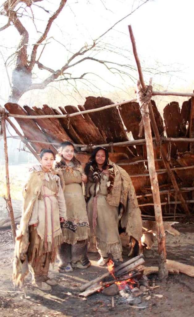Three Wampanoag Native American women pose for a photo at Plimoth Plantation.