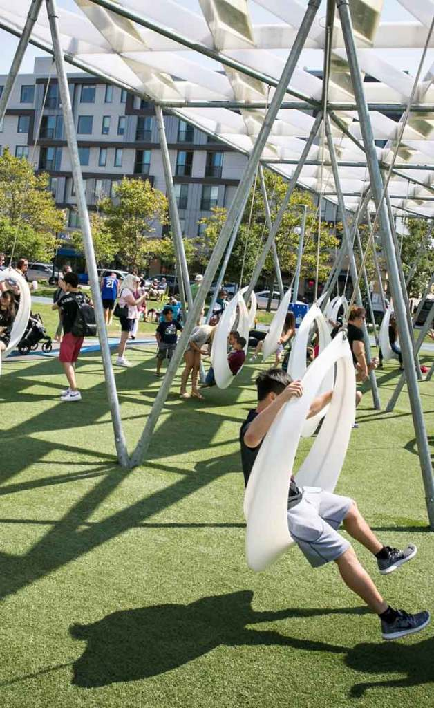 Snapshot of people on the circular swings at The Lawn on D in Boston, MA.