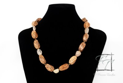 A warm, bright matinee necklace that pairs twisted palm wood with light orange to citrine ice flake quartz nuggets.