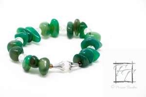bright green agate chunky stretch bracelet with black agate, crackle glass, and antiqued silver plate floral cones