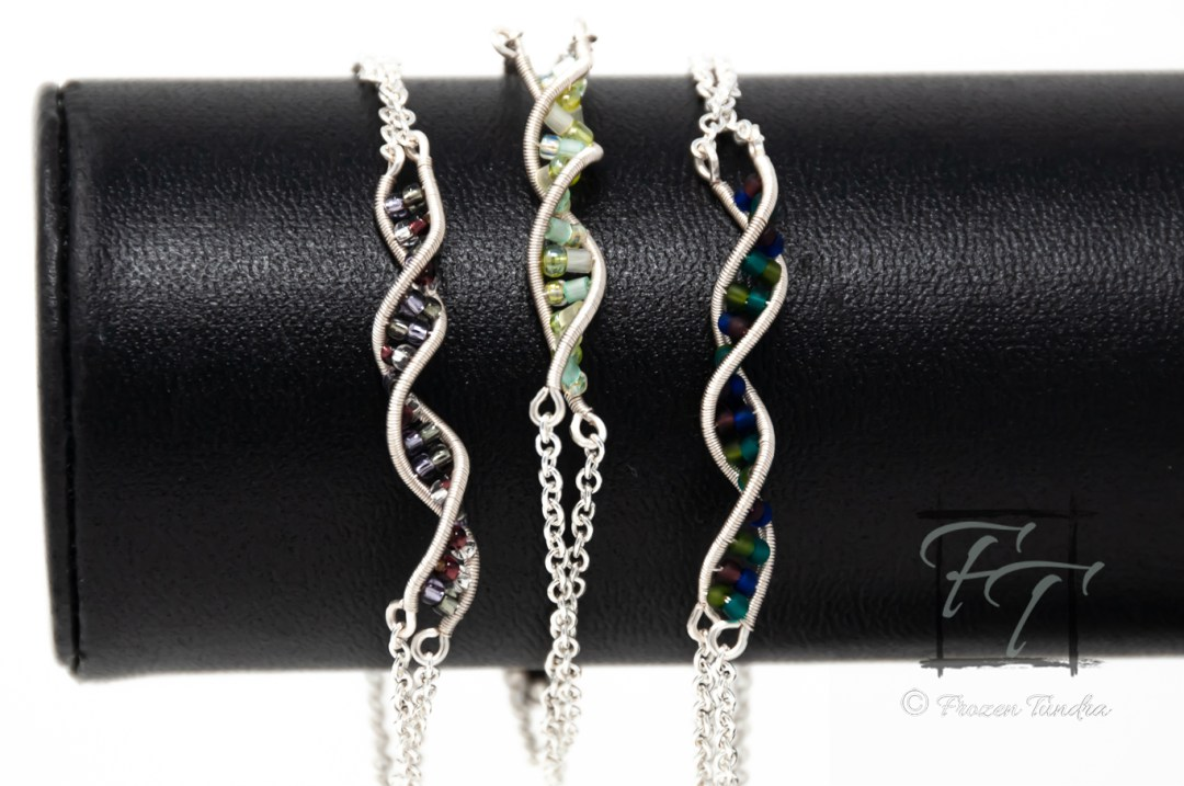 Silver double helix DNA strand bracelet hand-wrapped with glass beads in four shades