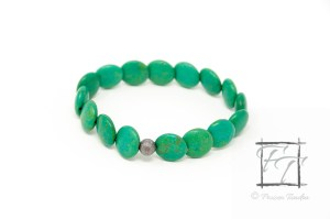 dyed green magnesite stretch bracelet with lentil-cut beads, giving the impression of cascading waves