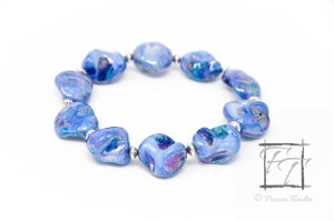 blue lagoon stretch bracelet with iridescent blue mother of pearl and silver plate