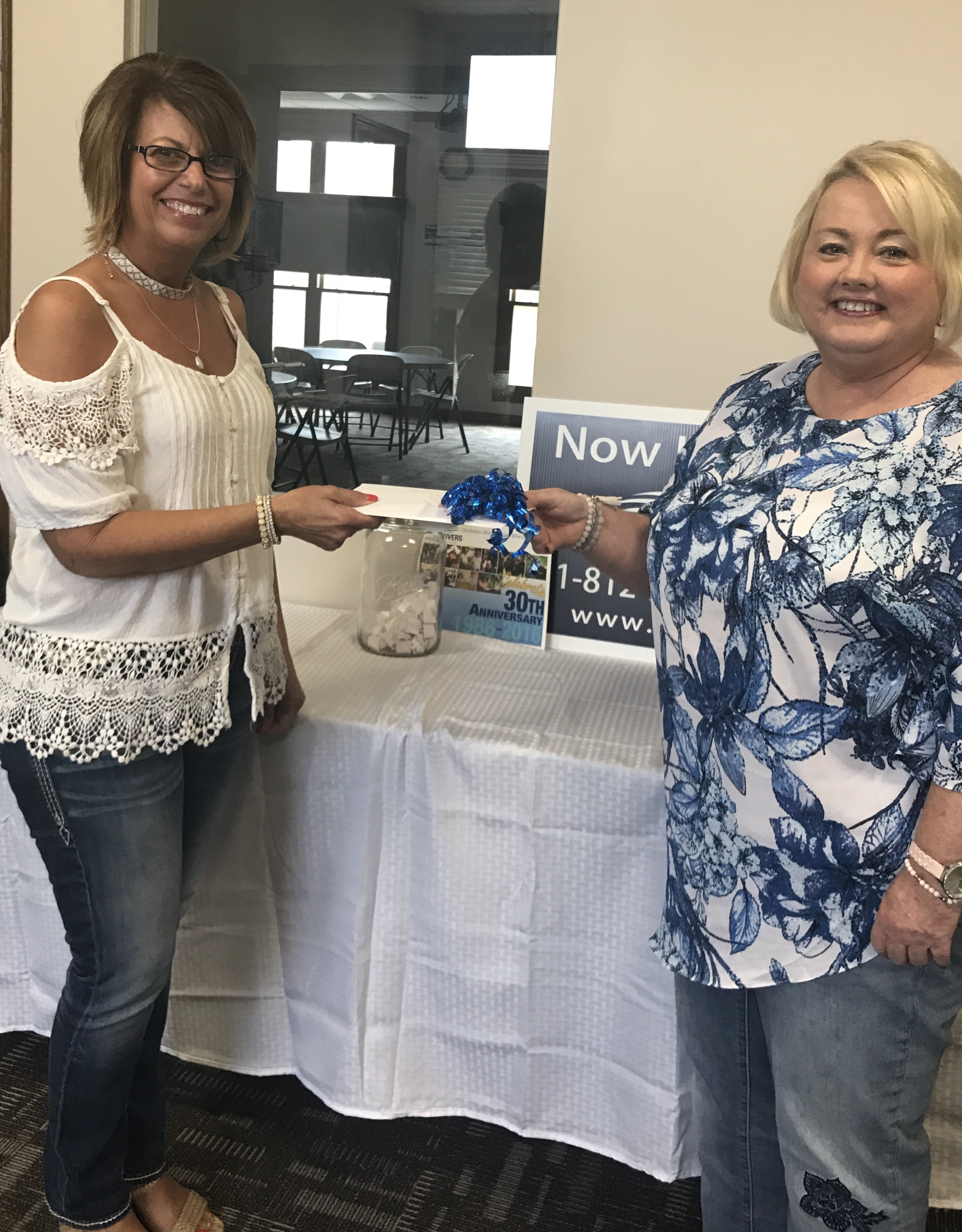 yle Ferrante who was Friday's winner from Daviess County Red Door receiving her Colts tickets and Visa gift cards from Sherri Tredway, Development Director