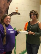 Taylar Mahurin-Earixson who was Wednesday's winner from Greene County Developmental Services receiving her rose gold iPad from Sherri Tredway, Development Director