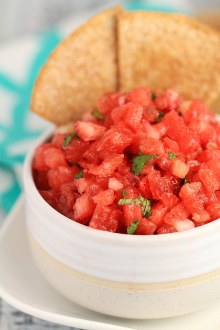Watermelon Salsa with Cinnamon Tortilla Chips is a refreshing summer dessert or appetizer, perfect for serving at backyard parties. Packed with juicy watermelon, this salsa is a quick and easy summer appetizer the whole family will love!