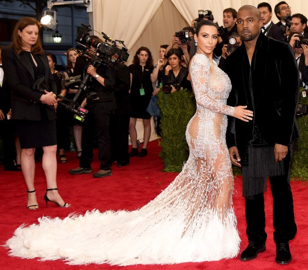 Mr and Mrs West were wearing Roberto Cavalli. Kim said that her dress was inspired by Cher's Met Gala look in 1971.
