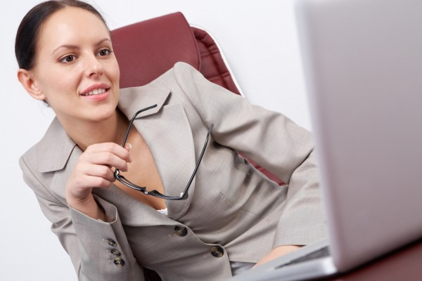 Woman in office looking at a laptop