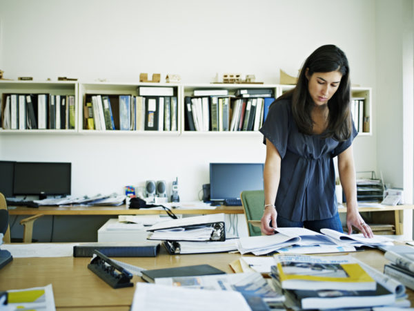 Female architect working at desk in an  office.